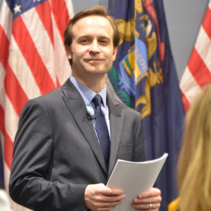 Brian Calley with Flags